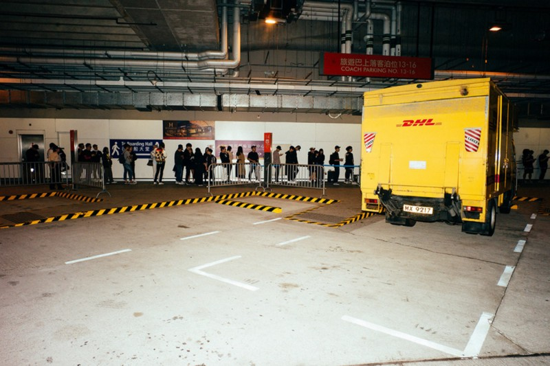 People lined up to buy high fashion clothing from a DHL truck in Hong Kong