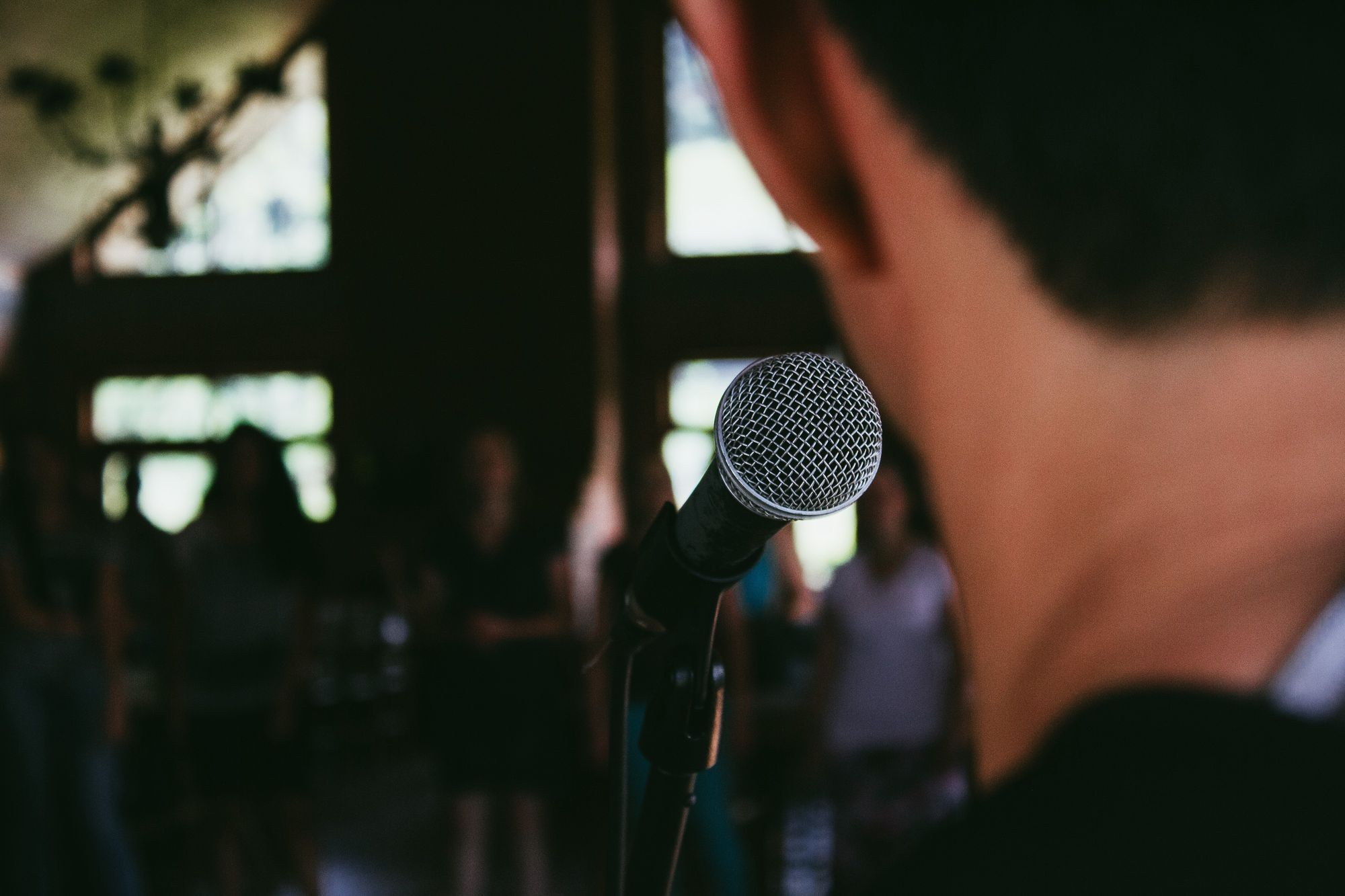 Image of speaker behind microphone