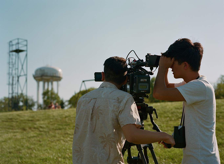 Photo of Dan Chen filming in small town America