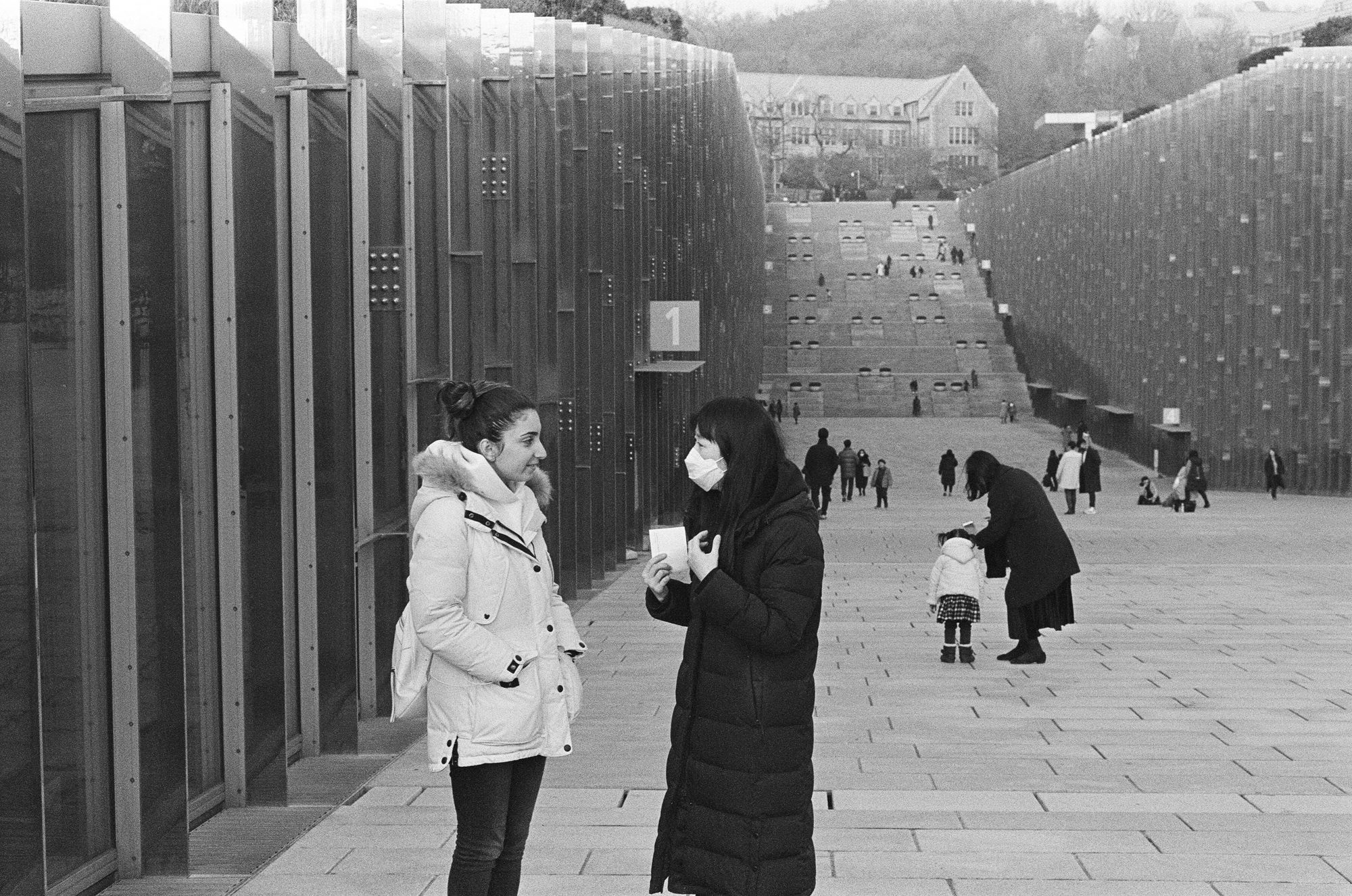 Photo of two women outside of Ehwa University, Seoul