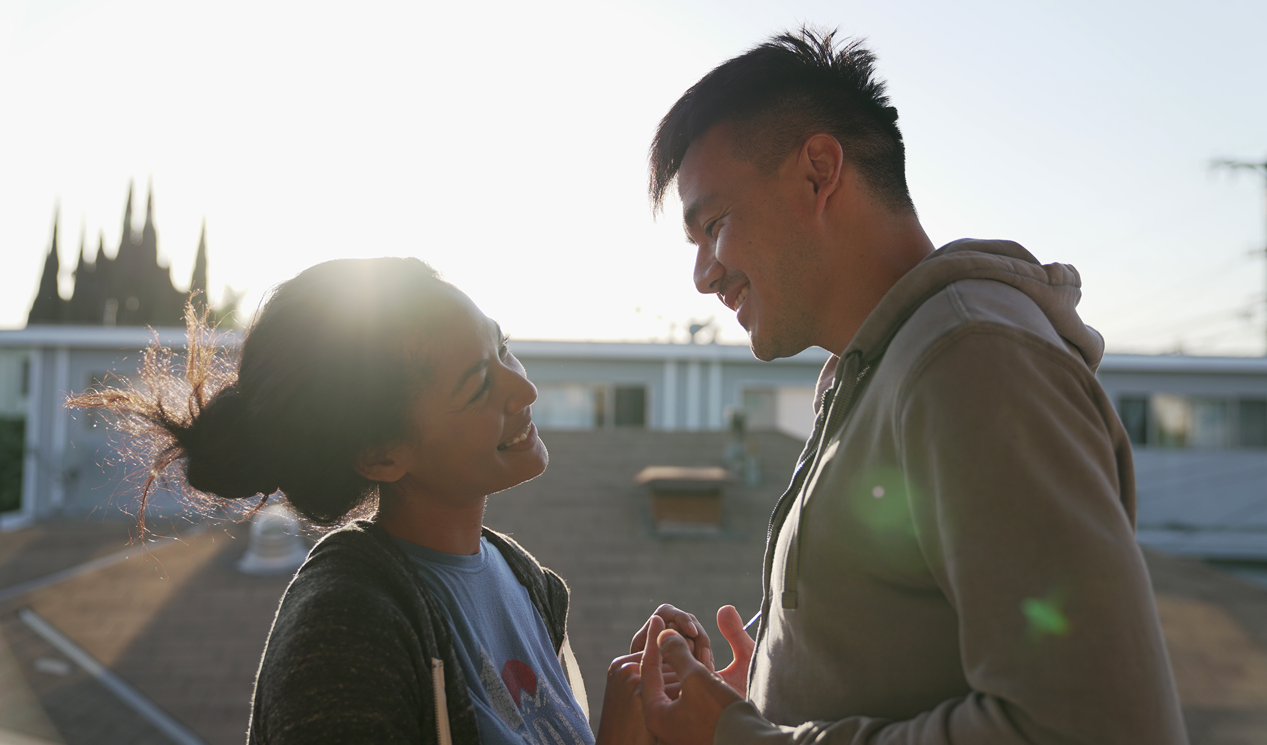 "Screenshot of Janine Oda and Phil Wang in ""Yappie"" by Wong Fu Productions"