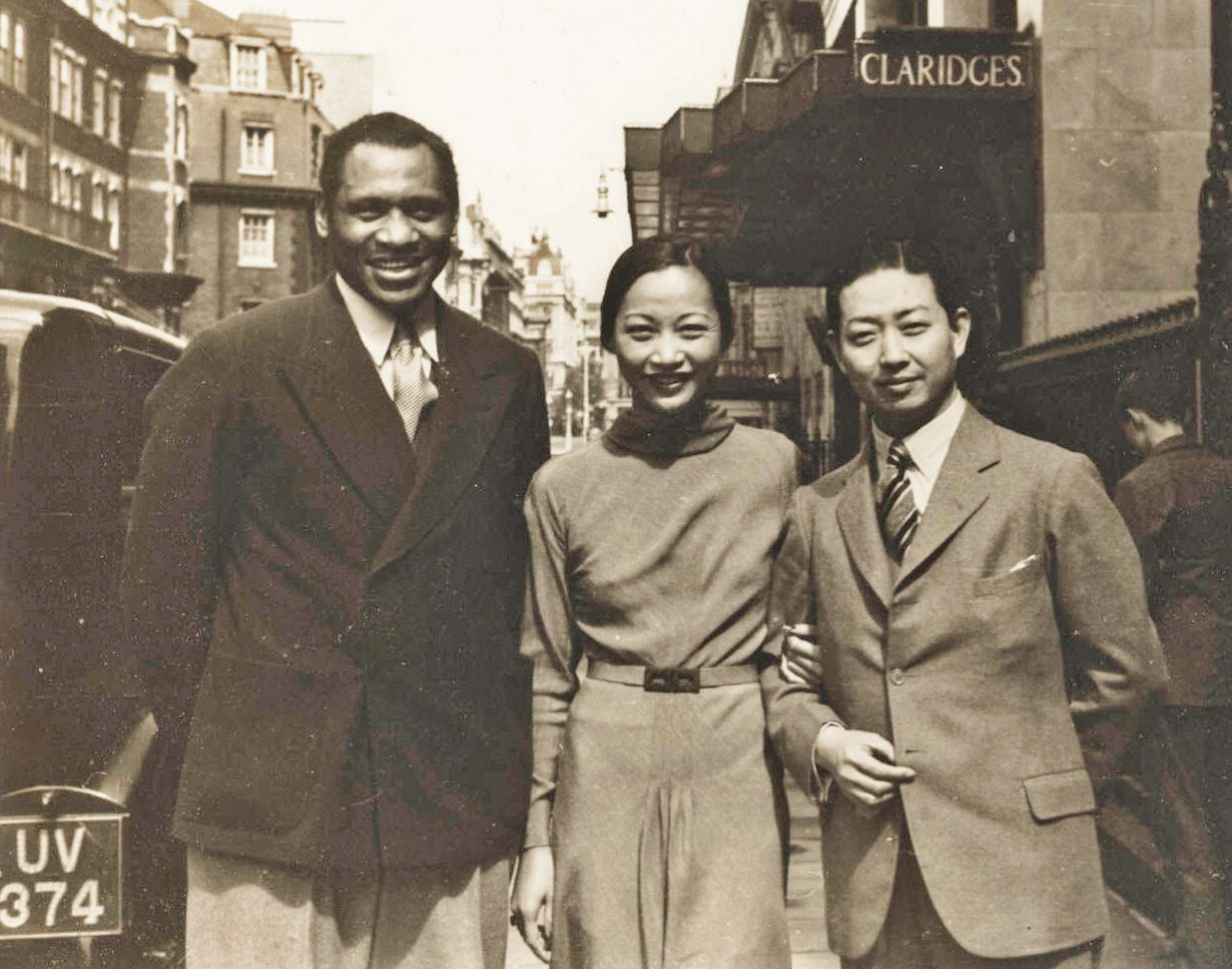 Image of Africa-American man and Asian couple